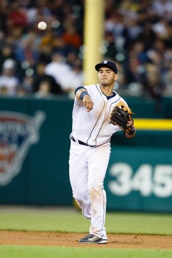 Jun 8, 2014; Detroit, MI, USA; Detroit Tigers shortstop Eugenio Suarez (30) makes a throw against the Boston Red Sox at Comerica Park. Mandatory Credit: Rick Osentoski-USA TODAY Sports