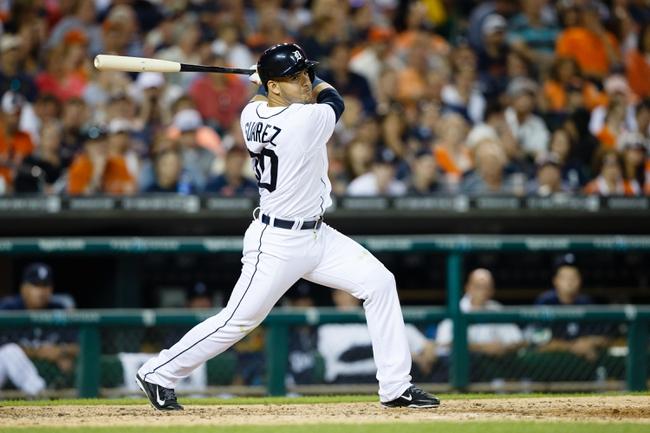 Jun 7, 2014; Detroit, MI, USA; Detroit Tigers shortstop Eugenio Suarez (30) at bat against the Boston Red Sox at Comerica Park. Mandatory Credit: Rick Osentoski-USA TODAY Sports