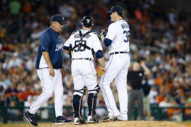 Jun 7, 2014; Detroit, MI, USA; Detroit Tigers pitching coach Jeff Jones (51) talks to catcher Bryan Holaday (50) and relief pitcher Joe Nathan (36) against the Boston Red Sox at Comerica Park. Mandatory Credit: Rick Osentoski-USA TODAY Sports