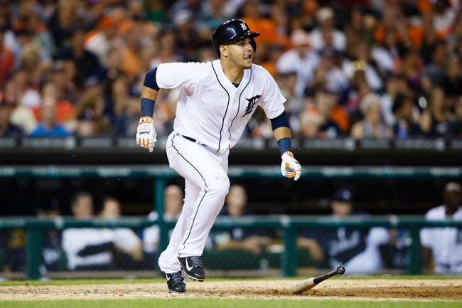 Jun 7, 2014; Detroit, MI, USA; Detroit Tigers shortstop Eugenio Suarez (30) runs to first against the Boston Red Sox at Comerica Park. Mandatory Credit: Rick Osentoski-USA TODAY Sports