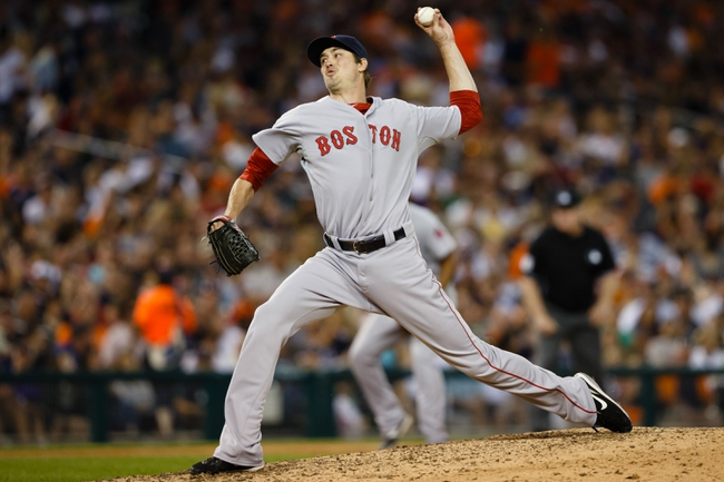 Jun 7, 2014; Detroit, MI, USA; Boston Red Sox relief pitcher Andrew Miller (30) pitches in the seventh inning against the Detroit Tigers at Comerica Park. Mandatory Credit: Rick Osentoski-USA TODAY Sports