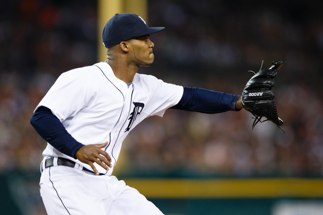 Jun 7, 2014; Detroit, MI, USA; Detroit Tigers relief pitcher Al Alburquerque (62) makes a catch against the Boston Red Sox at Comerica Park. Mandatory Credit: Rick Osentoski-USA TODAY Sports