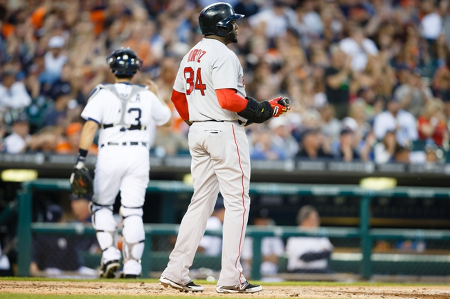Jun 8, 2014; Detroit, MI, USA; Boston Red Sox designated hitter David Ortiz (34) stands at home plate after striking out against the Detroit Tigers at Comerica Park. Mandatory Credit: Rick Osentoski-USA TODAY Sports