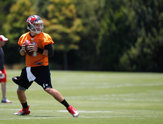 Jun 10, 2014; Tampa Bay, FL, USA;  Tampa Bay Buccaneers quarterback Alex Tanney (4) drops back as he works out for mini camp at One Buccaneer Place. Mandatory Credit: Kim Klement-USA TODAY Sports