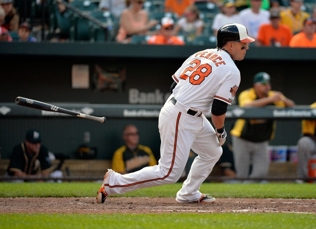 Jun 8, 2014; Baltimore, MD, USA; Baltimore Orioles designated hitter Steve Pearce (28) bats in the ninth inning against the Oakland Athletics at Oriole Park at Camden Yards. The Athletics defeated the Orioles 11-1. Mandatory Credit: Joy R. Absalon-USA TODAY Sports