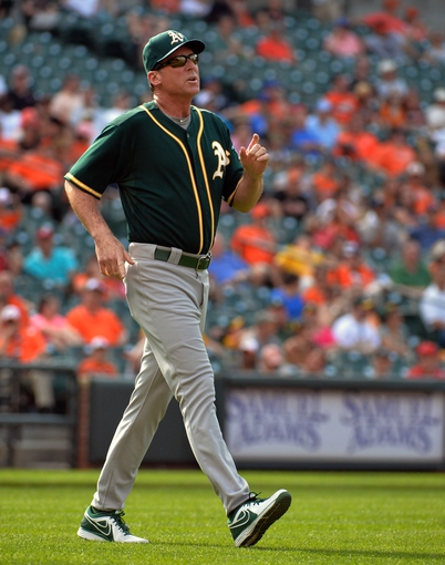 Jun 8, 2014; Baltimore, MD, USA; Oakland Athletics manager Bob Melvin (6) during a game against the Baltimore Orioles at Oriole Park at Camden Yards. The Athletics defeated the Orioles 11-1. Mandatory Credit: Joy R. Absalon-USA TODAY Sports