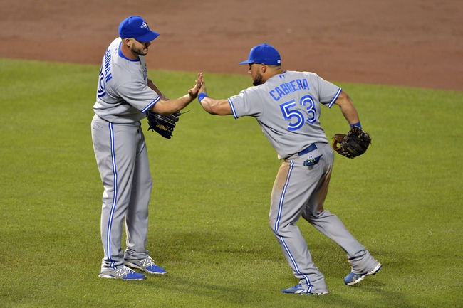 Jun 13, 2014; Baltimore, MD, USA; Toronto Blue Jays left fielder Melky Cabrera (53) celebrates with pitcher Dustin McGowan (29) after defeating Baltimore Orioles 4-0 at Oriole Park at Camden Yards. Mandatory Credit: Tommy Gilligan-USA TODAY Sports