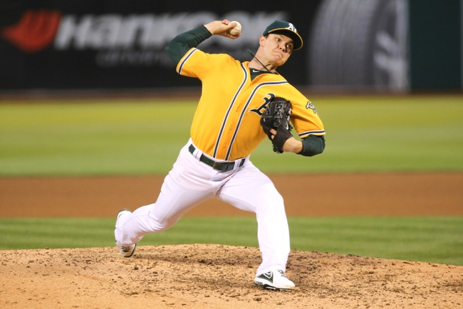 Jun 13, 2014; Oakland, CA, USA; Oakland Athletics starting pitcher Sonny Gray (54) pitches the ball during the fifth inning at O.co Coliseum. Mandatory Credit: Kelley L Cox-USA TODAY Sports