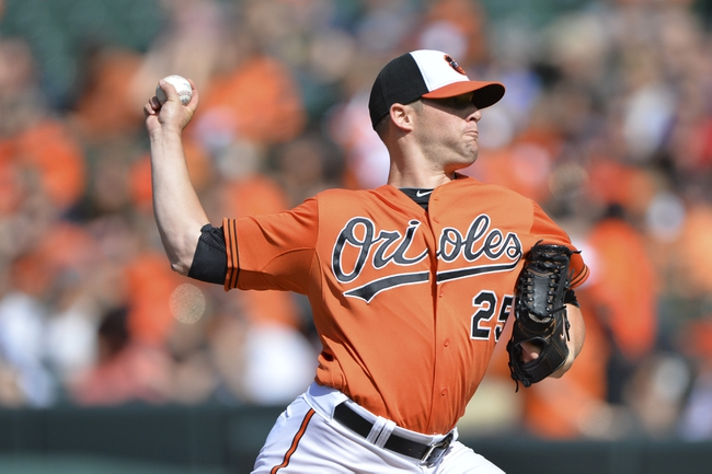 Jun 14, 2014; Baltimore, MD, USA; Baltimore Orioles starting pitcher Bud Norris (25) pitches during the first inning against the Toronto Blue Jays  at Oriole Park at Camden Yards. Mandatory Credit: Tommy Gilligan-USA TODAY Sports