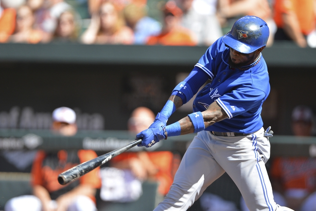 Jun 14, 2014; Baltimore, MD, USA; Toronto Blue Jays shortstop Jose Reyes (7) singles during the first inning against the Baltimore Orioles  at Oriole Park at Camden Yards. Mandatory Credit: Tommy Gilligan-USA TODAY Sports