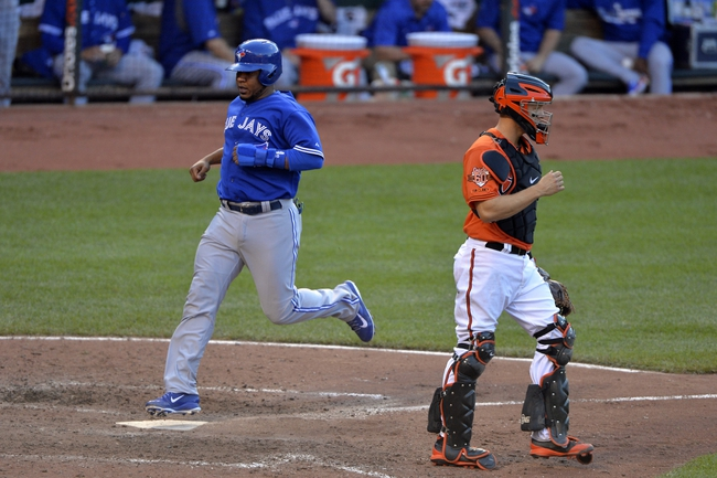 Jun 14, 2014; Baltimore, MD, USA;  Toronto Blue Jays first baseman Edwin Encarnacion (10) scores during the eighth inning against the Baltimore Orioles at Oriole Park at Camden Yards. Baltimore Orioles defeats the Toronto Blue Jays 3-2. Mandatory Credit: Tommy Gilligan-USA TODAY Sports