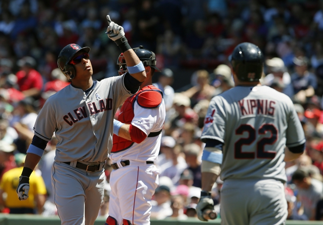 Jun 15, 2014; Boston, MA, USA; Cleveland Indians left fielder Michael Brantley (left) reacts after hitting a home run against the Boston Red Sox in the first inning at Fenway Park. Mandatory Credit: David Butler II-USA TODAY Sports