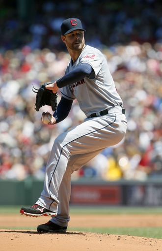 Jun 15, 2014; Boston, MA, USA; Cleveland Indians starting pitcher Corey Kluber (28) throws a pitch against the Boston Red Sox in the first inning at Fenway Park. Mandatory Credit: David Butler II-USA TODAY Sports