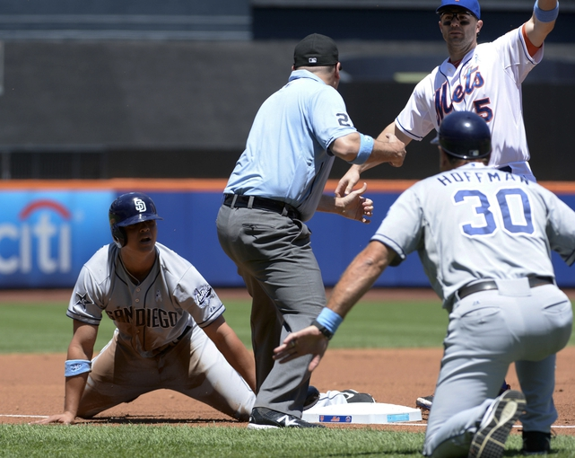 Jun 15, 2014; New York, NY, USA; New York Mets third baseman David Wright (5) tags out San Diego Padres right fielder Will Venable (25) during the game at Citi Field. Mandatory Credit: Robert Deutsch-USA TODAY Sports