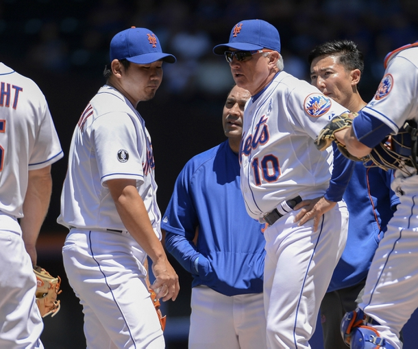 Jun 15, 2014; New York, NY, USA; New York Mets manager Terry Collins (10) speaks with New York Mets relief pitcher Daisuke Matsuzaka (16) during the first inning against the San Diego Padres at Citi Field. Matsuzaka would leave the game after the first inning. Mandatory Credit: Robert Deutsch-USA TODAY Sports