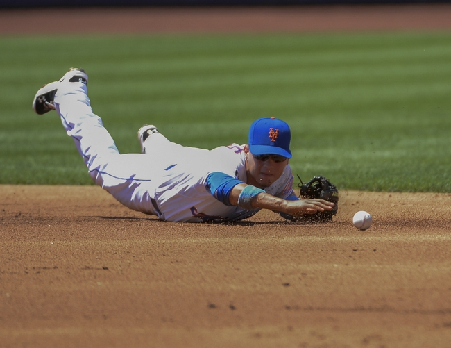 Jun 15, 2014; New York, NY, USA; New York Mets shortstop Wilmer Flores (4) cannot field a ground ball during the game against the San Diego Padres at Citi Field. Mandatory Credit: Robert Deutsch-USA TODAY Sports