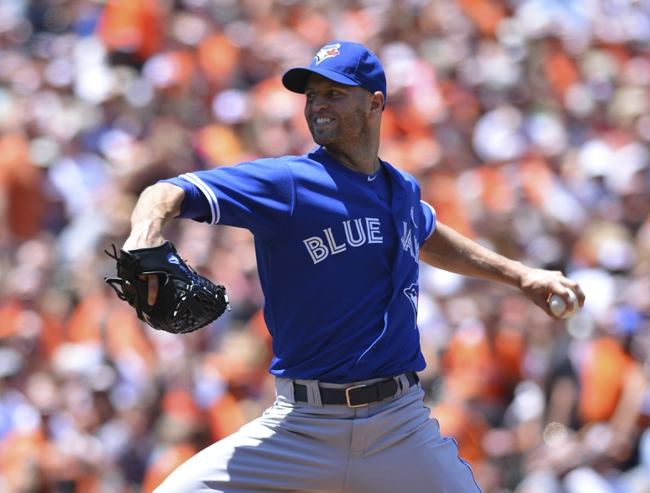 Jun 15, 2014; Baltimore, MD, USA;  Toronto Blue Jays starting pitcher J.A. Happ (48)  pitches during the first inning against the Baltimore Orioles at Oriole Park at Camden Yards. Mandatory Credit: Tommy Gilligan-USA TODAY Sports