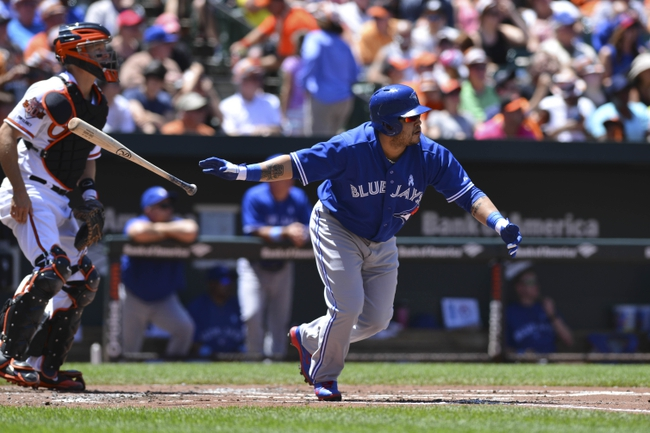 Jun 15, 2014; Baltimore, MD, USA;  Toronto Blue Jays catcher Dioner Navarro (30) doubles during the second inning against the Baltimore Orioles at Oriole Park at Camden Yards. Mandatory Credit: Tommy Gilligan-USA TODAY Sports