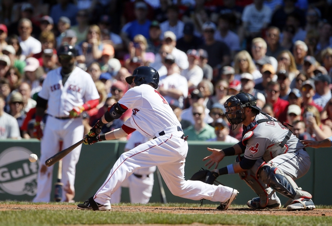 Jun 15, 2014; Boston, MA, USA; Boston Red Sox second baseman Dustin Pedroia (15) gets a base hit driving in the go ahead run in the fifth inning against the Cleveland Indians at Fenway Park. Mandatory Credit: David Butler II-USA TODAY Sports