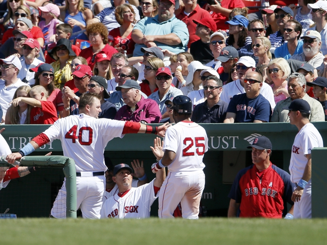 Jun 15, 2014; Boston, MA, USA; Boston Red Sox center fielder Jackie Bradley Jr. (25) is congratulated after scoring  after a base hit by second baseman Dustin Pedroia (15) (not pictured) in the fifth inning against the Cleveland Indians at Fenway Park. Mandatory Credit: David Butler II-USA TODAY Sports