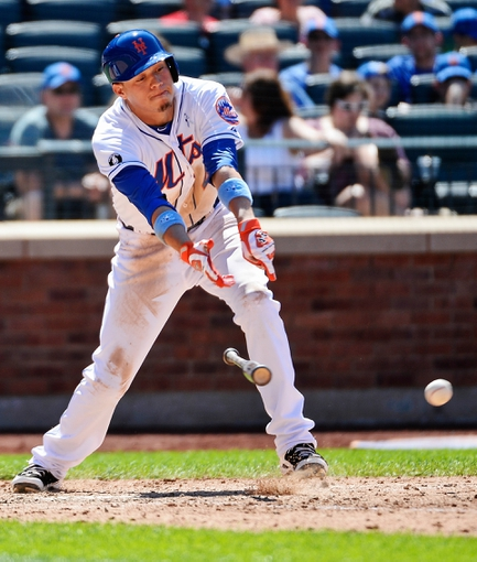 Jun 15, 2014; New York, NY, USA; New York Mets shortstop Wilmer Flores (4) loses his bat while singling during the game against the San Diego Padres at Citi Field. Mandatory Credit: Robert Deutsch-USA TODAY Sports