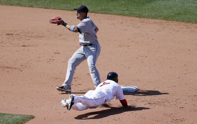 Jun 15, 2014; Boston, MA, USA; Boston Red Sox shortstop Stephen Drew (7) steels second base against Cleveland Indians shortstop Asdrubal Cabrera (13) in the seventh inning at Fenway Park. Mandatory Credit: David Butler II-USA TODAY Sports