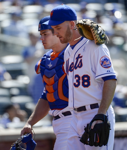 Jun 15, 2014; New York, NY, USA; New York Mets catcher Anthony Recker (20) speaks with relief pitcher Vic Black (38) during the game at Citi Field. Mandatory Credit: Robert Deutsch-USA TODAY Sports