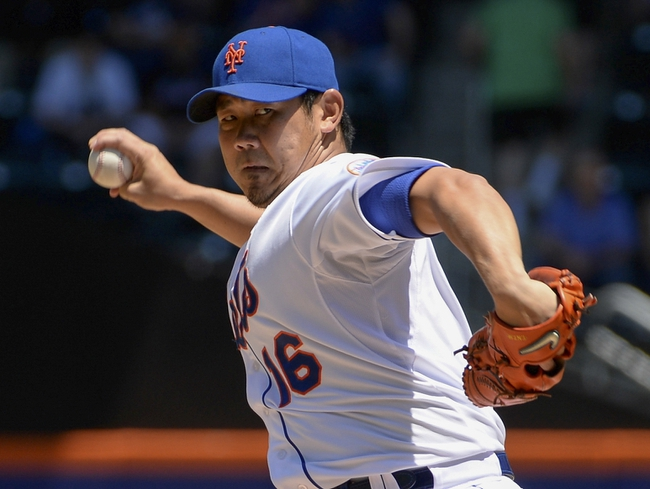 Jun 15, 2014; New York, NY, USA; New York Mets relief pitcher Daisuke Matsuzaka (16) throws during the game against the San Diego Padres at Citi Field. Mandatory Credit: Robert Deutsch-USA TODAY Sports
