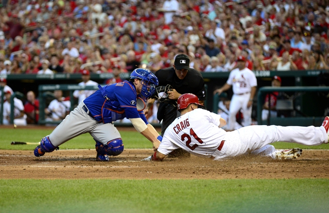 Jun 16, 2014; St. Louis, MO, USA; New York Mets catcher Taylor Teagarden (23) tags out St. Louis Cardinals right fielder Allen Craig (21) during the third inning at Busch Stadium. Mandatory Credit: Jeff Curry-USA TODAY Sports