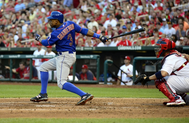 Jun 16, 2014; St. Louis, MO, USA; New York Mets center fielder Curtis Granderson (3) hits a sacrifice fly off of St. Louis Cardinals starting pitcher Carlos Martinez (not pictured) during the third inning at Busch Stadium. Mandatory Credit: Jeff Curry-USA TODAY Sports