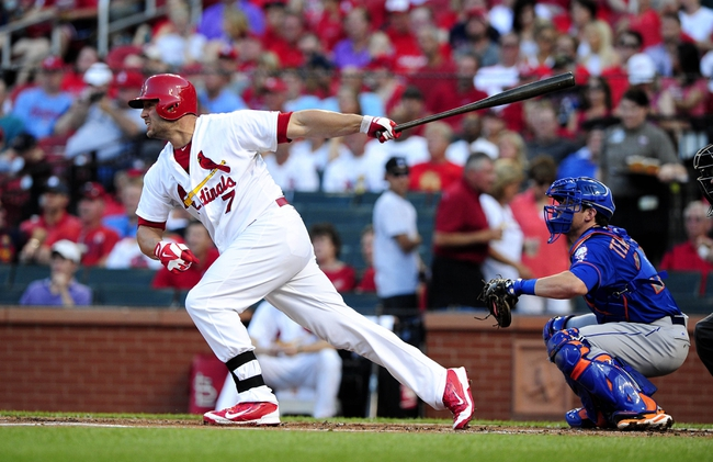 Jun 16, 2014; St. Louis, MO, USA; St. Louis Cardinals left fielder Matt Holliday (7) hits a single off of New York Mets starting pitcher Jacob deGrom (not pictured) during the first inning at Busch Stadium. Mandatory Credit: Jeff Curry-USA TODAY Sports