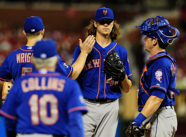 Jun 16, 2014; St. Louis, MO, USA; New York Mets starting pitcher Jacob deGrom (48) is removed from the game by manager Terry Collins (10) during the fifth inning against the St. Louis Cardinals at Busch Stadium. Mandatory Credit: Jeff Curry-USA TODAY Sports