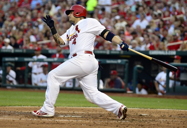 Jun 16, 2014; St. Louis, MO, USA; St. Louis Cardinals catcher Yadier Molina (4) hits a single off of New York Mets starting pitcher Jacob deGrom (not pictured) during the third inning at Busch Stadium. The Cardinals defeated the Mets 6-2. Mandatory Credit: Jeff Curry-USA TODAY Sports