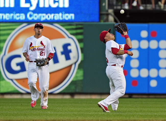 Jun 16, 2014; St. Louis, MO, USA; St. Louis Cardinals second baseman Kolten Wong (16) catches a fly ball hit by New York Mets catcher Taylor Teagarden (not pictured) during the fourth inning at Busch Stadium. The Cardinals defeated the Mets 6-2. Mandatory Credit: Jeff Curry-USA TODAY Sports