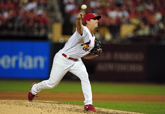 Jun 16, 2014; St. Louis, MO, USA; St. Louis Cardinals relief pitcher Seth Maness (61) throws to a New York Mets batter during the eighth inning at Busch Stadium. The Cardinals defeated the Mets 6-2. Mandatory Credit: Jeff Curry-USA TODAY Sports