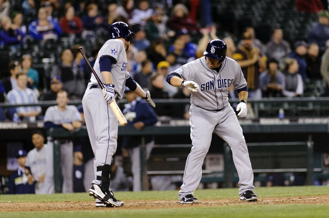 Jun 16, 2014; Seattle, WA, USA; San Diego Padres third baseman Chase Headley (left) and designated hitter Carlos Quentin (right) celebrate after Quentin hit a solo home run against the Seattle Mariners during the ninth inning at Safeco Field. Seattle defeated San Diego 5-1. Mandatory Credit: Steven Bisig-USA TODAY Sports