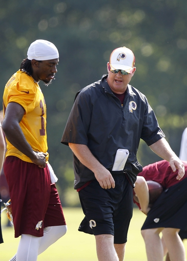 Jun 17, 2014; Ashburn, VA, USA; Washington Redskins quarterback Robert Griffin III (10) talks with Redskins head coach Jay Gruden during minicamp at Redskins Park. Mandatory Credit: Geoff Burke-USA TODAY Sports