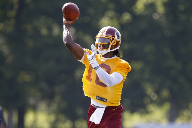 Jun 17, 2014; Ashburn, VA, USA; Washington Redskins quarterback Robert Griffin III (10) throws the ball during minicamp at Redskins Park. Mandatory Credit: Geoff Burke-USA TODAY Sports