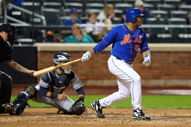 Jun 13, 2014; New York, NY, USA; New York Mets right fielder Bobby Abreu (53) hits an RBI single against the San Diego Padres during the seventh inning of a game at Citi Field. The Mets defeated the Padres 6-2. Mandatory Credit: Brad Penner-USA TODAY Sports