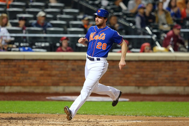 Jun 13, 2014; New York, NY, USA; New York Mets second baseman Daniel Murphy (28) scores a run against the San Diego Padres during the fifth inning of a game at Citi Field. The Mets defeated the Padres 6-2. Mandatory Credit: Brad Penner-USA TODAY Sports