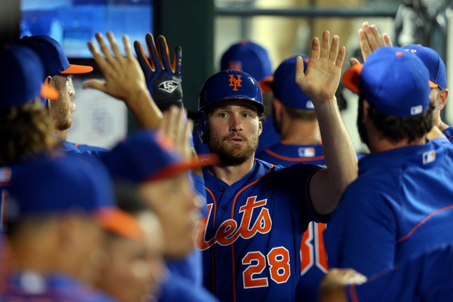 Jun 13, 2014; New York, NY, USA; New York Mets second baseman Daniel Murphy (28) is congratulated after scoring a run against the San Diego Padres during the fifth inning of a game at Citi Field. The Mets defeated the Padres 6-2. Mandatory Credit: Brad Penner-USA TODAY Sports