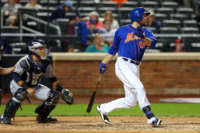 Jun 13, 2014; New York, NY, USA; New York Mets first baseman Lucas Duda (21) hits an RBI double against the San Diego Padres during the fourth inning of a game at Citi Field. The Mets defeated the Padres 6-2. Mandatory Credit: Brad Penner-USA TODAY Sports