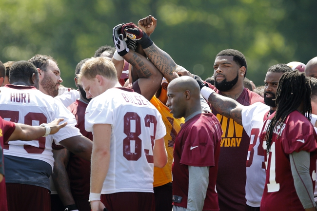 Jun 17, 2014; Ashburn, VA, USA; Washington Redskins players huddle after a minicamp session at Redskins Park. Mandatory Credit: Geoff Burke-USA TODAY Sports