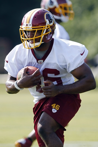 Jun 17, 2014; Ashburn, VA, USA; Washington Redskins running back Alfred Morris (46) carries the ball during minicamp at Redskins Park. Mandatory Credit: Geoff Burke-USA TODAY Sports