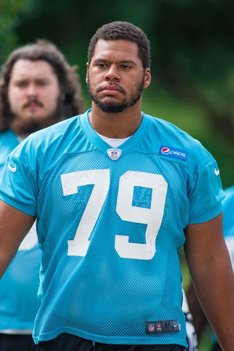 Jun 17, 2014; Charlotte, NC, USA; Carolina Panthers tackle Andrew McDonald walks to the practice field prior to the start of the minicamp held at the Carolina Panthers practice facility. Mandatory Credit: Jeremy Brevard-USA TODAY Sports