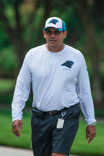 Jun 17, 2014; Charlotte, NC, USA; Carolina Panthers head coach Ron Rivera walks to the practice field prior to the start of the minicamp held at the Carolina Panthers practice facility. Mandatory Credit: Jeremy Brevard-USA TODAY Sports