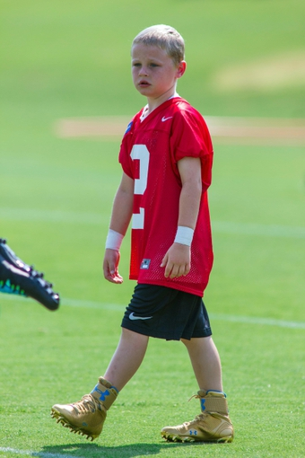 Jun 17, 2014; Charlotte, NC, USA; Carolina Panthers fan George Gring walks on the practice field at the Carolina Panthers practice facility. Gring was drafted by the Panthers through the Make-A-Wish foundation. Mandatory Credit: Jeremy Brevard-USA TODAY Sports