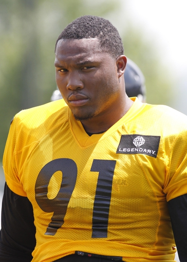Jun 17, 2014; Pittsburgh, PA, USA; Pittsburgh Steelers defensive end Stephon Tuitt (90) participates in drills during minicamp at the UPMC Sports Performance Complex. Mandatory Credit: Charles LeClaire-USA TODAY Sports