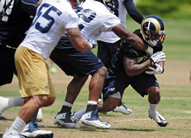 Jun 17, 2014; St. Louis, MO, USA; St. Louis Rams running back Tre Mason (27) carries the ball during minicamp at Rams Park. Mandatory Credit: Jeff Curry-USA TODAY Sports