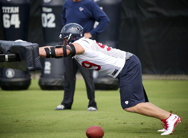 Jun 17, 2014; Houston, TX, USA; Houston Texans defensive end J.J. Watt (99) goes through drills during mini camp at Houston Methodist Training Center. Mandatory Credit: Andrew Richardson-USA TODAY Sports